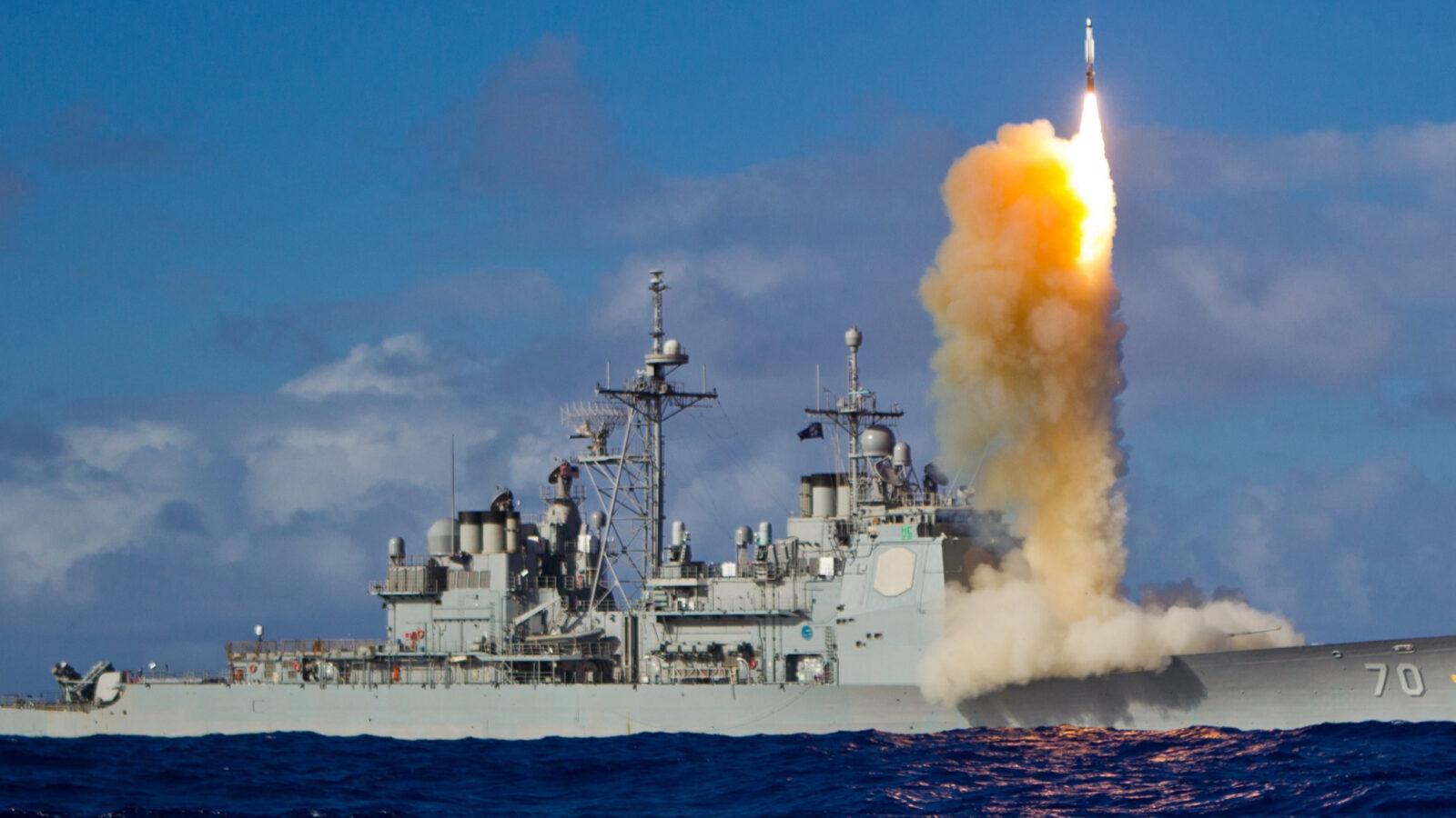 Aegis cruiser firing missiles