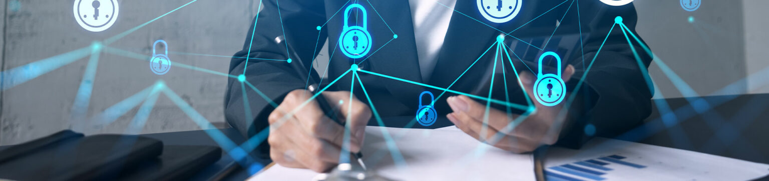 Businessman at a desk with security lock icons